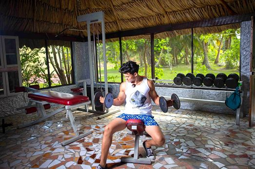 working out in Weights Room at Belize Boutique Resort & Spa