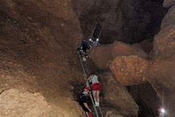 ATM Cave Belize Photo of guests climbing ladder in cave